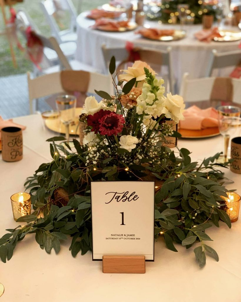 Nature inspired floral centrepieces on timber slabs