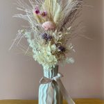 Small preserved lilac, pinks and creams vased arrangement
